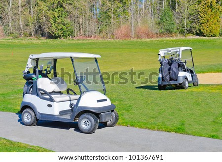 Two carts on the golf course.