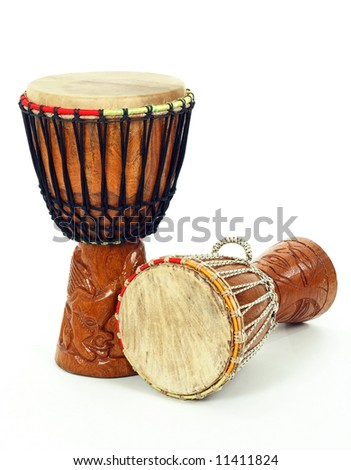 Two carved African djembe drums on white background. - stock photo