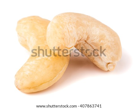 two cashew nuts on a white background close-up - stock photo