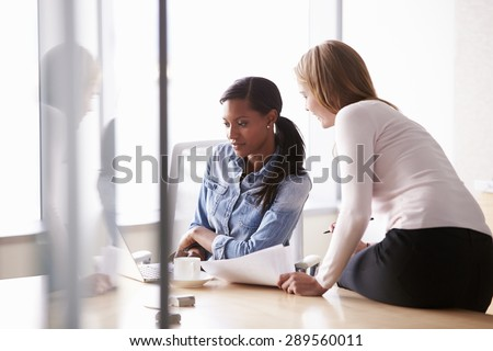 Two Casually Dressed Businesswomen Working In Office - stock photo