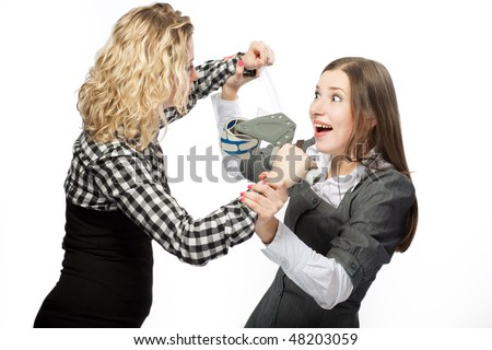 two caucasian girls playing with tape device trying to glue mouth with scotch tape having fun isolated over white background