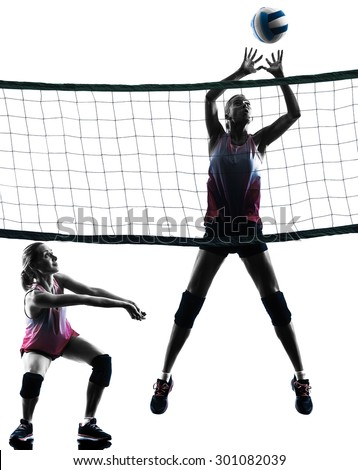 two caucasian women volleyball in studio silhouette isolated on white background - stock photo