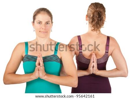 Two Caucasian yoga women in Namaskar posture - stock photo