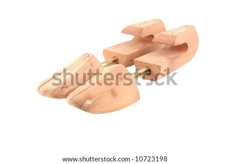 two cedar shoe trees on a white background - stock photo