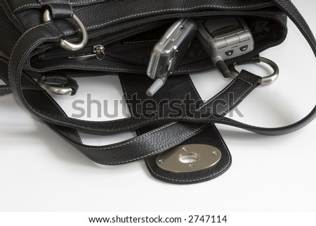 Two Cell phones in lady bag