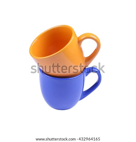 Two ceramic bright orange and deep blue cups isolated on white background. Two cups isolated on white - stock photo