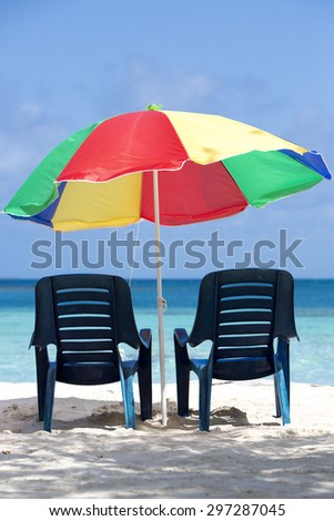 Two chairs and umbrella on stunning tropical beach in Morrocoy National park, Venezuela - stock photo