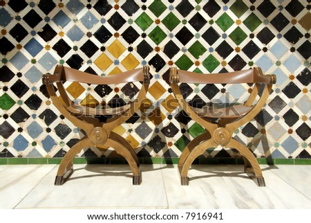Two chairs at the Alhambra, in Granada Spain. This is an UNESCO World Heritage site - stock photo