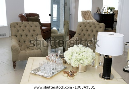 two chairs for relaxing in the living room beside the table - stock photo
