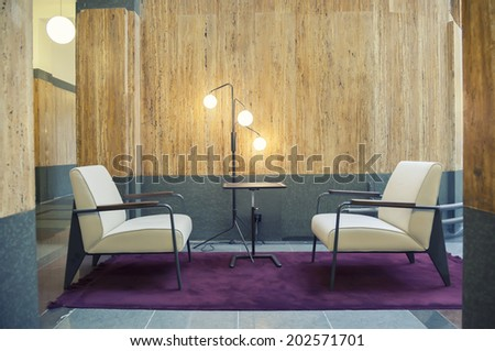 two chairs in hall of office building  - stock photo