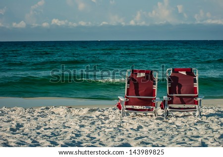 two chairs on a beach with gulf of mexico background - stock photo
