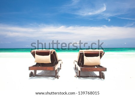 two chairs on perfect tropical beach. Tulum, Mexico - stock photo