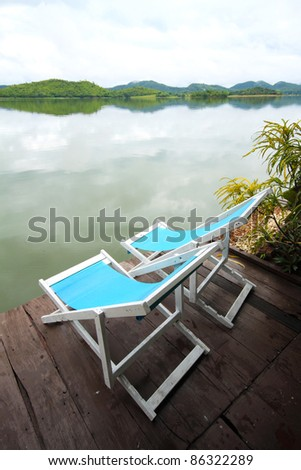 Two chairs on the lake - stock photo