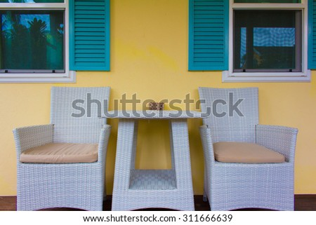 Two chairs on wooden deck. Modern outdoor furniture on wooden deck - stock photo