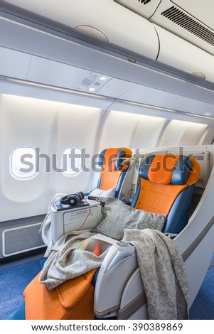 two chairs prepared to sleep in the airplane salon (vertical) - stock photo