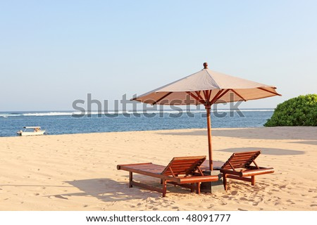 two chairs & umbrella - stock photo