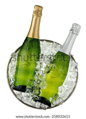 Two champagne bottles in a bucket with ice, top view - stock photo