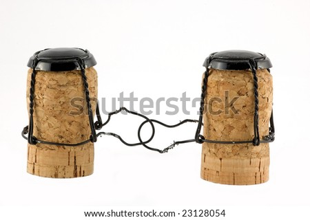 Two champagne corks isolated on white