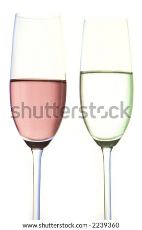 Two champagne flutes with exotic cocktail concoction against white background lighting.