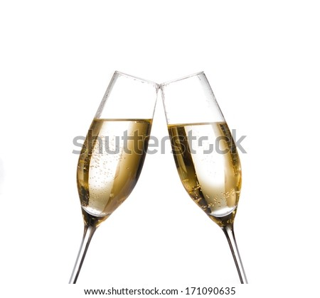two champagne flutes with golden bubbles make cheers on white background with space for text - stock photo