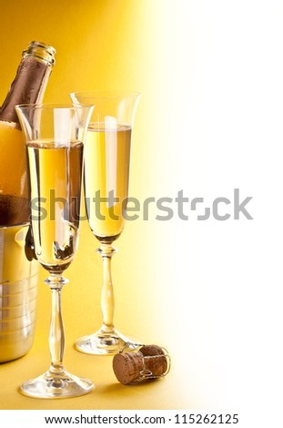 Two champagne glass on a yellow background.