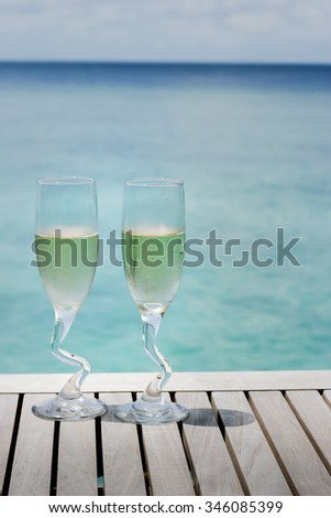 Two champagne glasses by the ocean, time for celebration taken at Maldives