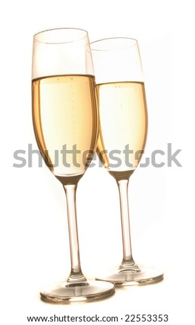 two champagne glasses filled with bubbly sparkling wine