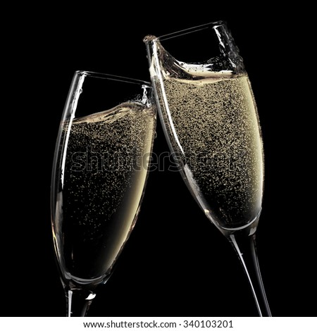 Two champagne glasses. Isolated on black background - stock photo