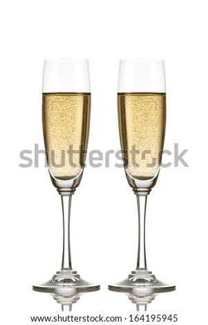 Two champagne glasses isolated on white - stock photo