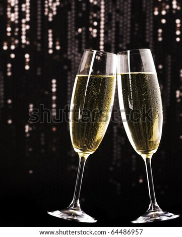 Two champagne glasses on holiday background - stock photo