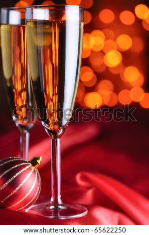 two champagne glasses on red silk - stock photo