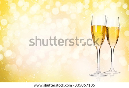 Two champagne glasses over christmas background with copy space - stock photo