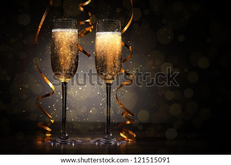 Two champagne glasses ready to bring in the New Year - stock photo