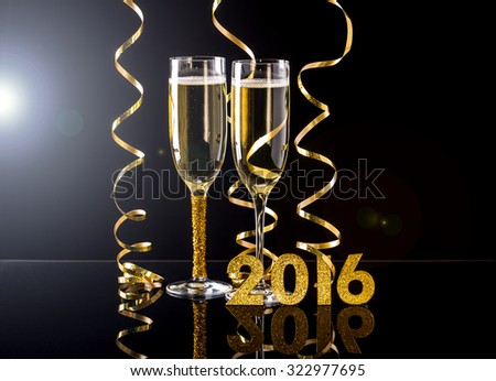 Two champagne glasses ready to bring in the 2016 New Year - stock photo