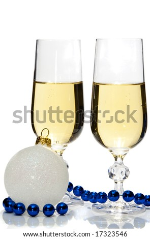 Two champagne glasses with blue beads and a white Christmas ball, isolated - stock photo