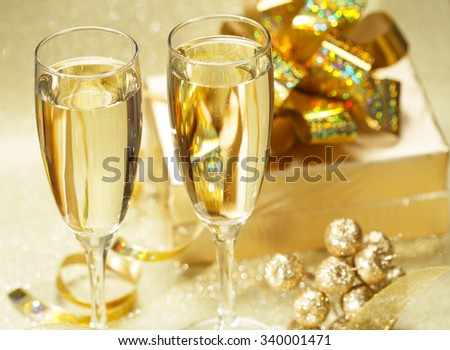 Two champagne glasses with gift boxes - stock photo