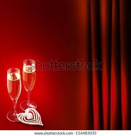 two champagne glasses with heart on red background - stock photo
