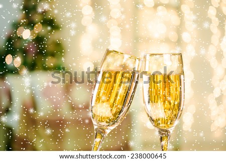Two Champagne Glasses With Snow and Stars On Defocused Background Living Room With Christmas Tree - stock photo