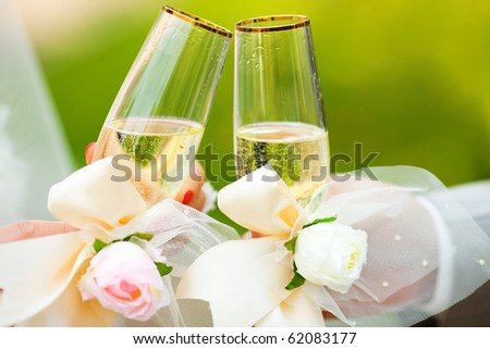 Two Champagne in hands of  new married couple closeup - stock photo