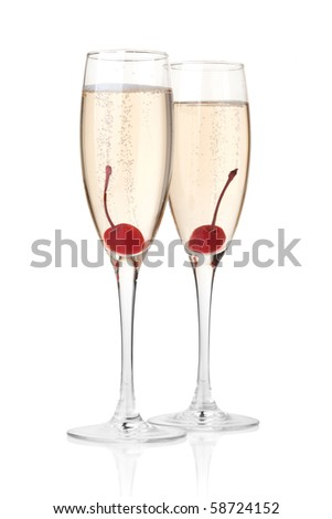 Two champagne with maraschino in glass. Isolated on white background - stock photo