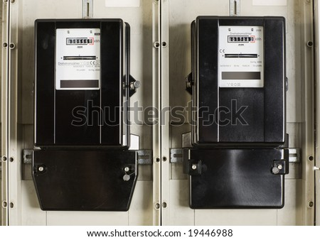 Two change electricity meters in the cellar - stock photo