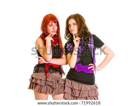 Two charming young girlfriends thinking about problems isolated on white - stock photo