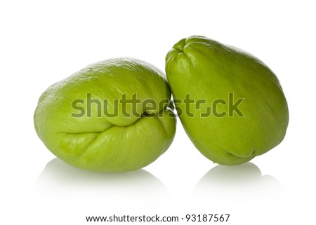 Two chayote squash, also known as christophine, pear-squash, vegetable pear and choko against a white background. - stock photo