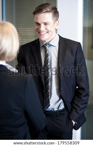 Two cheerful business colleagues communicating - stock photo