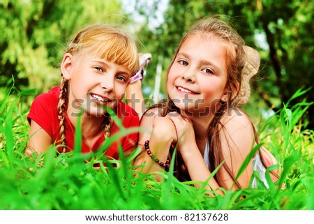 Two cheerful girls having fun outdoors.