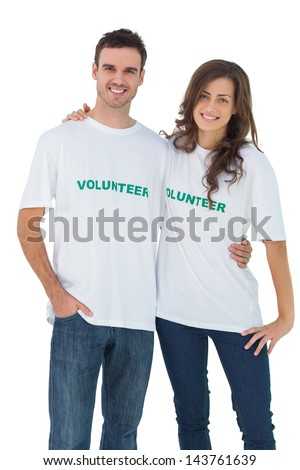 Two cheerful people wearing volunteer tshirt on white background