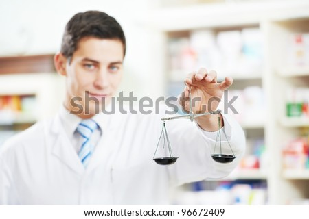 Two cheerful pharmacist chemist  worker standing in pharmacy drugstore - stock photo