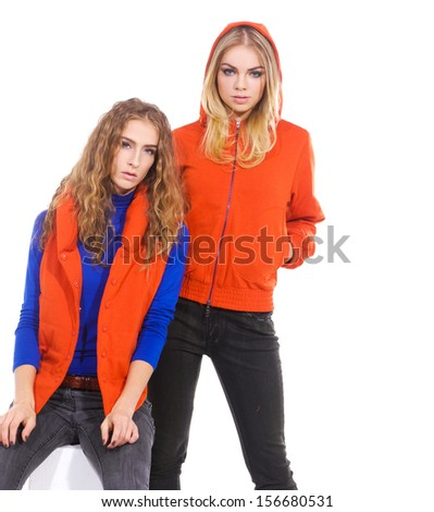 Two cheerful standing on white background - stock photo