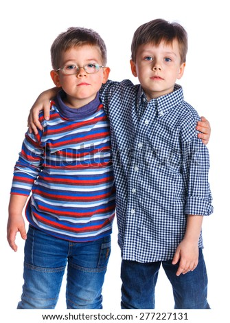 Two cheerful young boys are standing together. Isolated on the white background - stock photo
