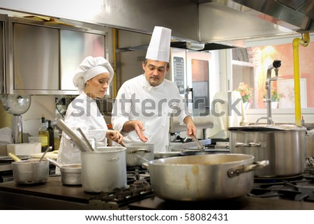Two chef are working together - stock photo